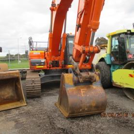 Doosan DX300LC Excavator in Yard with other machinery