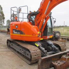 Doosan DX140LCR Outdoors with arm raised