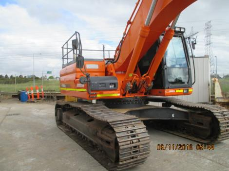 Doosan DX300LC Excavator with arm up in the air